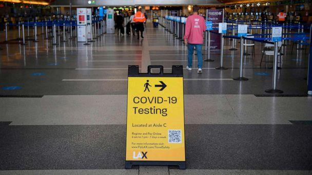 PHOTO: A sign directing people to Covid-19 testing is displayed by check-in counters at Los Angeles International Airport (LAX) amid increased Covid-19 travel restrictions, Jan. 25, 2021 in Los Angeles. (Patrick T. Fallon/AFP via Getty Images)