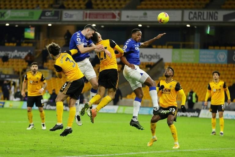 Michael Keane (second left)heads home Everton's winner to beat Wolves 2-1