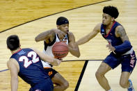 Liberty's Kyle Rode (22) strips the ball from Oklahoma State guard Avery Anderson III, center as Chris Harris Jr. also defends during the first half of a first round NCAA college basketball game Friday, March 19, 2021, at the Indiana Farmers Coliseum in Indianapolis.(AP Photo/Charles Rex Arbogast)