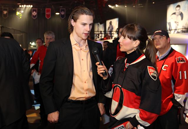 OTTAWA, ON - JANUARY 27: Erik Karlsson (L) of the Ottawa Senators speaks to fans during the NHL Fan Fair at the Ottawa Convention Centre on January 27, 2012 in Ottawa, Ontario, Canada. (Photo by Bruce Bennett/Getty Images)