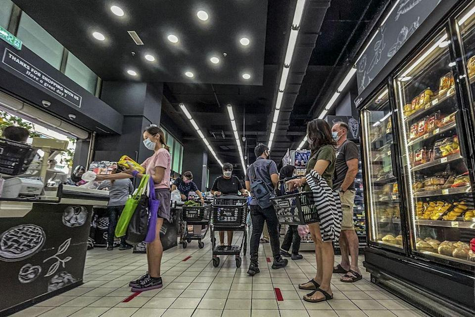 People shop for groceries at the Mercato Solaris supermarket in Mont Kiara June 7, 2021. — Picture by Hari Anggara
