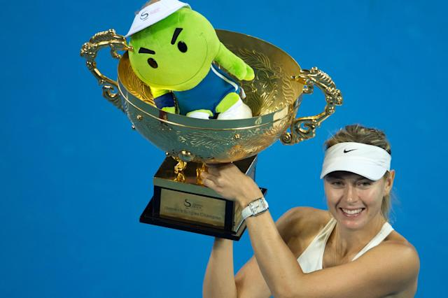 Maria Sharapova celebrates winning the China Open in Beijing on October 5, 2014 (AFP Photo/Fred Dufour)