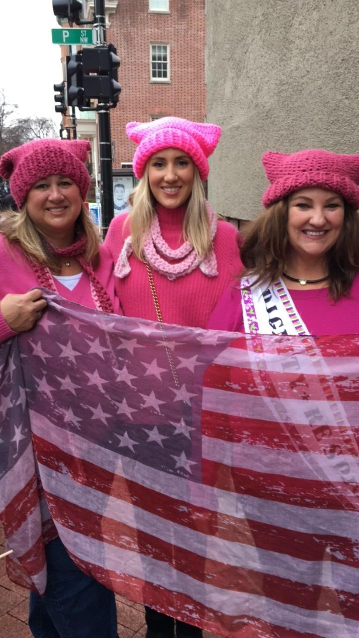 <p>Sisters Kathryn Compton (of Los Angeles) and Meg Tworkowski (of Florida) met up with Tworkowski's daughter Chelsea Poling in their own homemade hats. The sisters' hats were knit by their mom in Mission Viejo — as were the extras Compton had in her bag for cousins they were meeting up with. Poling's came from Code Pink. (Photo: Beth Greenfield) </p>