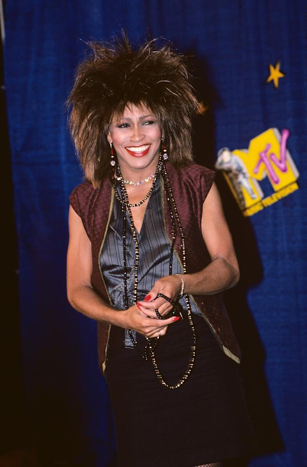 Tina Turner rocked her iconic choppy, voluminous locks with full bangs and a bold red lip in 1984.