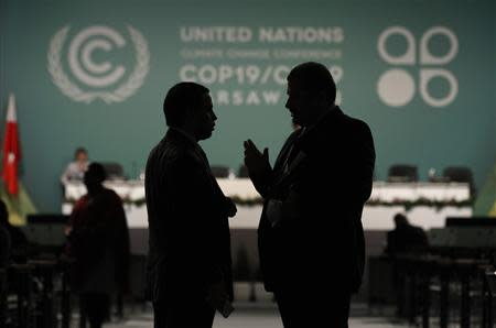 Delegates talk during a break in a plenary session at the COP19 in Warsaw