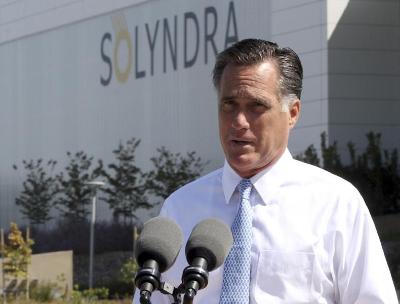 """FILE - In this May 31, 2012 file photo, Republican presidential candidate, former Massachusetts Gov. Mitt Romney speaks outside the Solyndra manufacturing facility, in Fremont, Calif. Romney says Friday's jobs report is """"devastating news"""" for American workers and families. (AP Photo/Mary Altaffer, File)"""