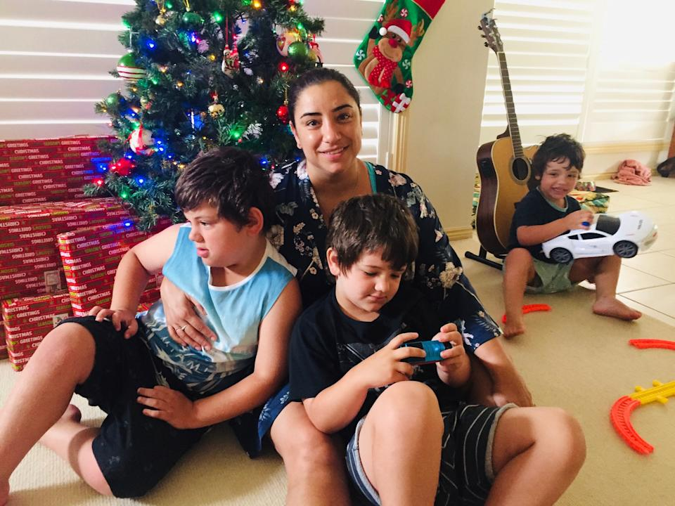 Katherine with her autistic sons Oliver Joshua and Tyler.