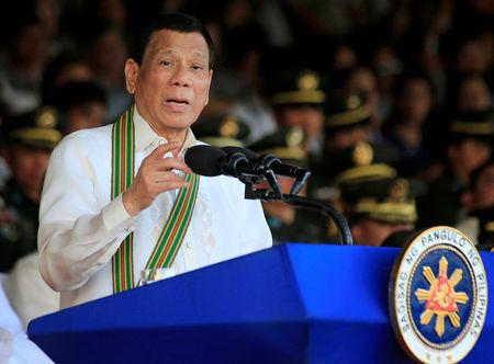 Philippine President Rodrigo Duterte gestures as he delivers a speech during the 121st founding anniversary of the Philippine Army at Taguig city, Metro Manila
