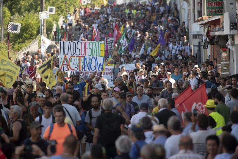 Protestors march during the annual G7 summit.