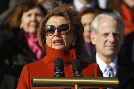 U.S. House Minority Leader Nancy Pelosi (D-CA), standing with fellow House Democrats, delivers remarks on immigration legislation on the steps of the U.S. Capitol in Washington January 13, 2015.  REUTERS/Jonathan Ernst