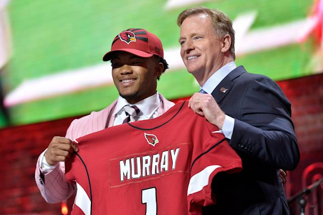 Oklahoma quarterback Kyler Murray, left, stands on stage with NFL commissioner Roger Goodell after being drafted by the Arizona Cardinals. (AP)