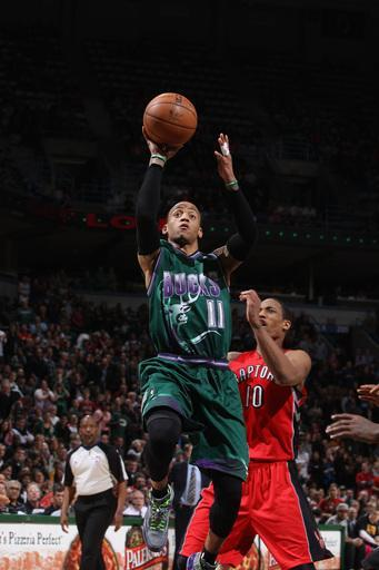 MILWAUKEE, WI - MARCH 2: Monta Ellis #11 of the Milwaukee Bucks shoots against DeMar DeRozan #10 of the Toronto Raptors on March 2, 2013 at the BMO Harris Bradley Center in Milwaukee, Wisconsin. (Photo by Gary Dineen/NBAE via Getty Images)