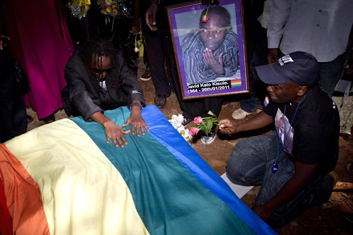 Members of the Ugandan gay community attend a funeral of murdured gay rights activist David Kato, at his parental home close to the town of Mataba on January 28, 2011 (AFP Photo/Marc Hofer)