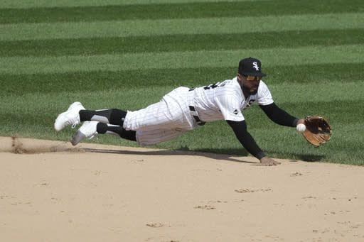 Chicago White Sox shortstop Leury Garcia tries to catch a single by Cleveland Indians' Jose Ramirez during the seventh inning of a baseball game in Chicago, Saturday, Aug. 8, 2020. (AP Photo/Nam Y. Huh)