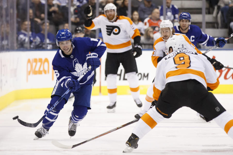 FILE - In this Nov. 9, 2019, file photo, Toronto Maple Leafs center Mitch Marner (16) passes the puck upice during the first period of an NHL hockey game against the Philadelphia Flyers in Toronto. The rear-view mirror is something Toronto stars Marner and Auston Matthews are doing their best to ignore as the NHL season approaches. (Cole Burston/The Canadian Press via AP, File)