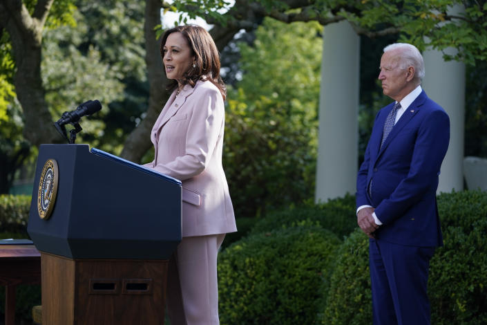 President Joe Biden listens as Vice President Kamala Harris speaks before the signing of a bill in the Rose Garden of the White House, in Washington, Thursday, Aug. 5, 2021, that awards Congressional gold medals to law enforcement officers that protected members of Congress at the Capitol during the Jan. 6 riot. (AP Photo/Evan Vucci)