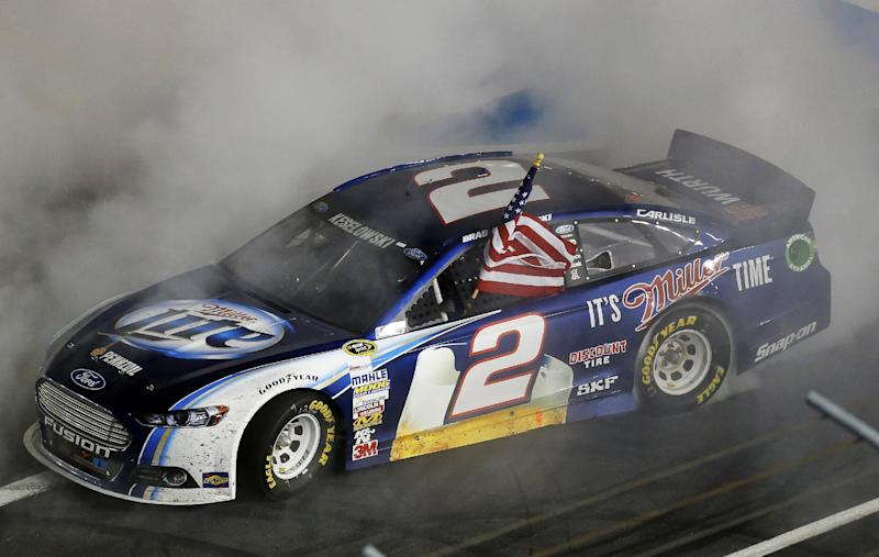 Brad Keselowski celebrates with a burnout after winning the NASCAR Sprint Cup Series auto race at Charlotte Motor Speedway in Concord, N.C., Saturday, Oct. 12, 2013. (AP Photo/Chris Keane)