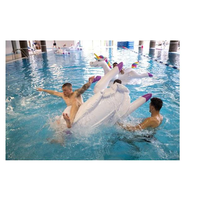 Jordan Pickford and Harry Maguire play with inflatable unicorns in the pool during a recovery session at the ForRestMix Hotel in Repino (REX)