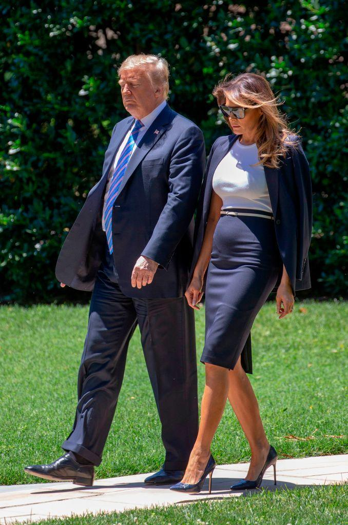 The presidential couple departed the White House en route to Joint Base Andrews on 18 July. For the engagement, Melania opted for a navy-hued skirt suit. [Photo: Getty]