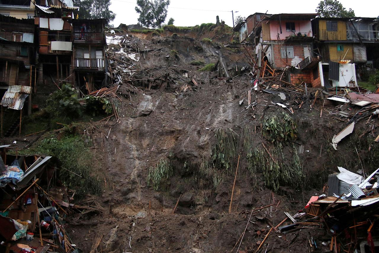<p>View of a neighborhood destroyed after mudslides, caused by heavy rains leading several rivers to overflow, pushing sediment and rocks into buildings and roads, in Manizales, Colombia, April 19, 2017. (Santiago Osorio/Reuters) </p>