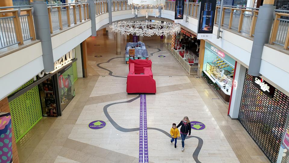 Usually-busy shopping centres like Bluewater in Kent were also left empty after the new tighter restrictions came into force on Sunday. (PA)