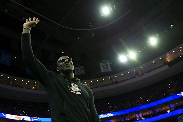 "Hall of Famer Terrell Owens salutes the crowd during an NBA playoff game between the <a class=""link rapid-noclick-resp"" href=""/nba/teams/philadelphia/"" data-ylk=""slk:Sixers"">Sixers</a> and Raptors in Philadelphia on May 5. (Getty Images)"