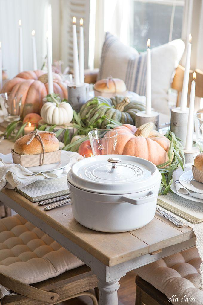 """<p>The secret to this charming fall tablescape? Set the table first, then fill in the open space with pumpkins and rustic DIY candlesticks.</p><p><strong>Get the tutorial at <a href=""""http://www.ellaclaireinspired.com/fall-tablescape/"""" rel=""""nofollow noopener"""" target=""""_blank"""" data-ylk=""""slk:Ella Claire"""" class=""""link rapid-noclick-resp"""">Ella Claire</a>.</strong></p><p><strong><a class=""""link rapid-noclick-resp"""" href=""""https://go.redirectingat.com?id=74968X1596630&url=https%3A%2F%2Fwww.wayfair.com%2Fdecor-pillows%2Fpdp%2Fbirch-3-piece-hurricane-set-lfmf2363.html&sref=https%3A%2F%2Fwww.countryliving.com%2Fentertaining%2Fg2130%2Fthanksgiving-centerpieces%2F"""" rel=""""nofollow noopener"""" target=""""_blank"""" data-ylk=""""slk:SHOP HURRICANE SET"""">SHOP HURRICANE SET</a></strong></p>"""
