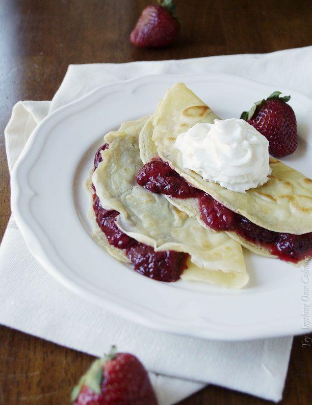 """<p>The filling is TDF.</p><p>Get the recipe from <a href=""""http://www.tryanythingonceculinary.com/strawberry-filled-crepes-sundaysupper/"""" rel=""""nofollow noopener"""" target=""""_blank"""" data-ylk=""""slk:Try Anything Once"""" class=""""link rapid-noclick-resp"""">Try Anything Once</a>.</p>"""