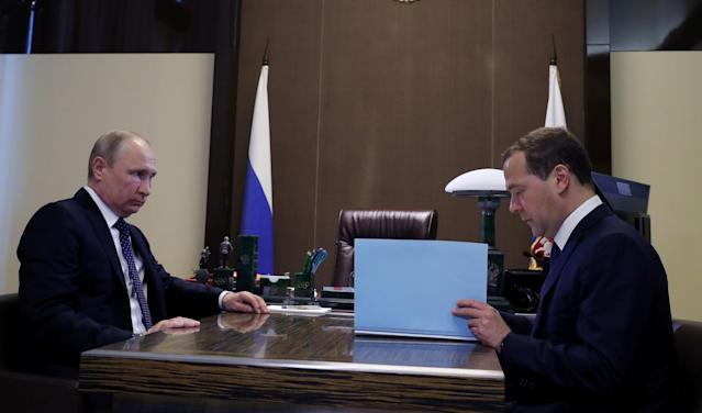 Russian President Vladimir Putin meets with Prime Minister Dmitry Medvedev in the Black Sea resort of Sochi, Russia May 18, 2018. Sputnik/Mikhail Klimentyev/Kremlin via REUTERS ATTENTION EDITORS - THIS IMAGE WAS PROVIDED BY A THIRD PARTY.