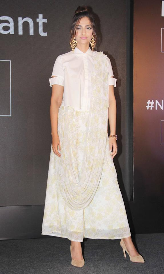 <p>The fashionista never gets it wrong. We spotted the actress in a white flowy dress with draping details. Style tip to take from here: Add statement earrings to an otherwise plain white outfit to make it look more dressy. </p>