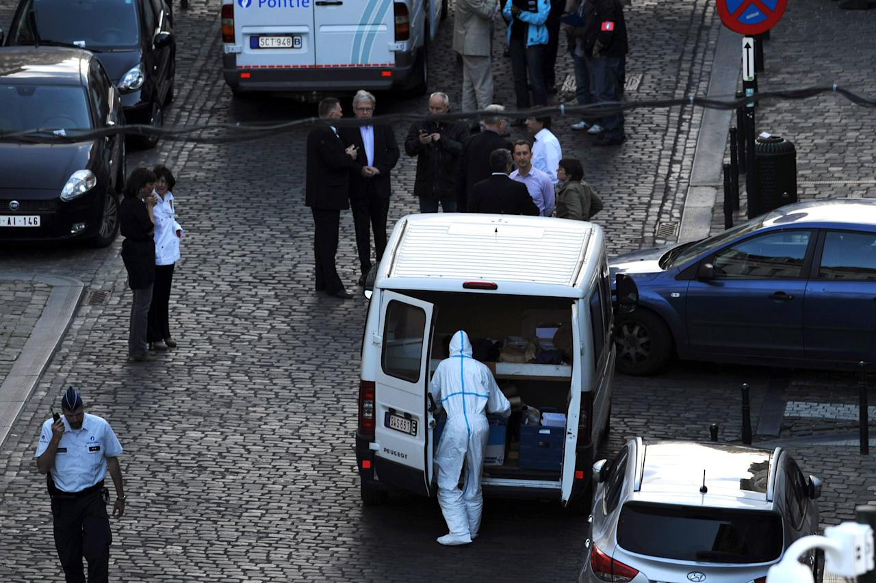 Police personnel are seen at the site of a shooting in central Brussels May 24, 2014. Three people were killed and one seriously injured during the shooting at the Jewish Museum in central Brussels on Saturday, with Belgium's interior minister saying anti-Semitic motives could be behind the attack. REUTERS/Eric Vidal (BELGIUM - Tags: CRIME LAW TPX IMAGES OF THE DAY)