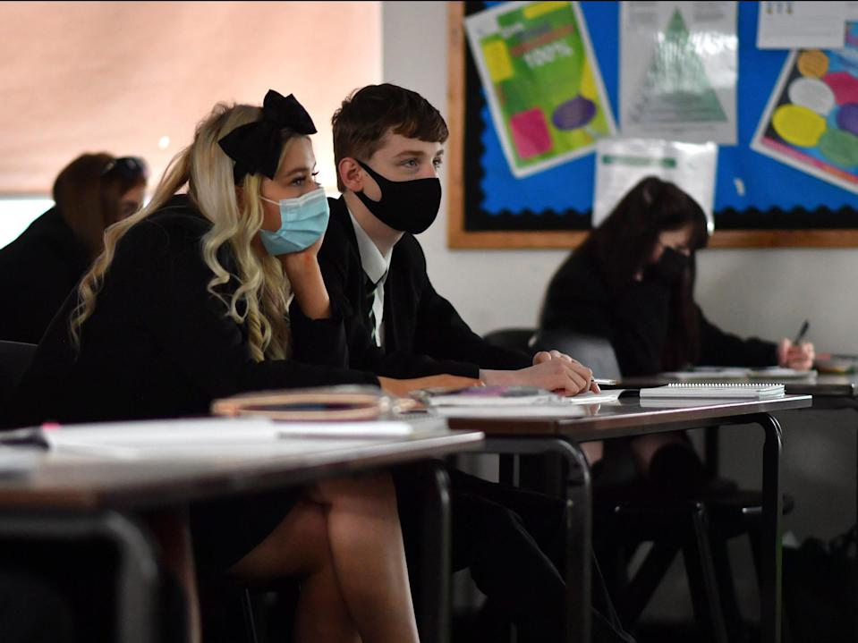 <p>The government has been urged not to drop advice over face masks in secondary school classrooms next month</p> (Getty Images)