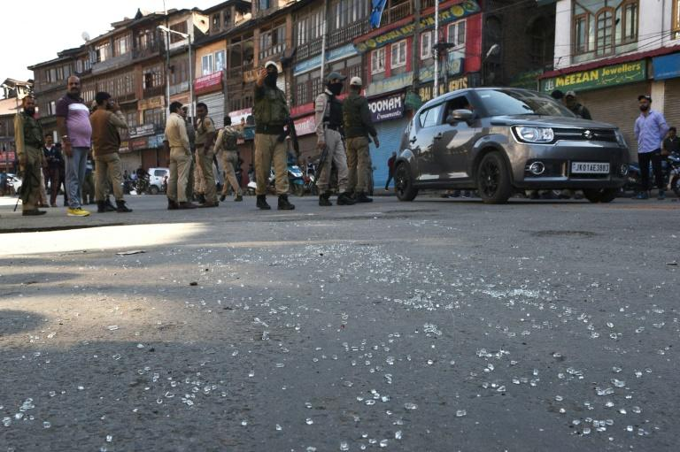 Security forces stand guard after a grenade attack that police said injured seven people in Srinagar, the main city of Indian-administered Kashmir, on October 12, 2019 (AFP Photo/HABIB NAQASH)