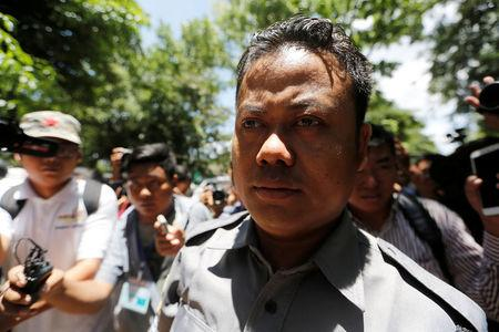 Myanmar police officer Naing Lin arrives at a court hearing in the case of Reuters journalists in Yangon, Myanmar May 16, 2018. REUTERS/Ann Wang