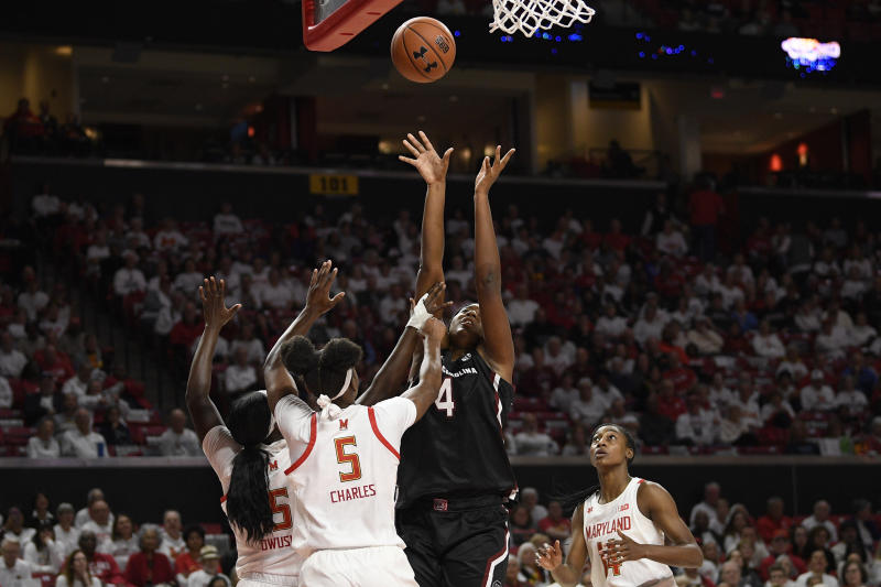 South Carolina forward Aliyah Boston (4) shoots as Maryland guards Kaila Charles (5), Ashley Owusu (15) and Diamond Miller (14) defend during the first half of an NCAA college basketball game, Sunday, Nov. 10, 2019, in College Park, Md. (AP Photo/Nick Wass)