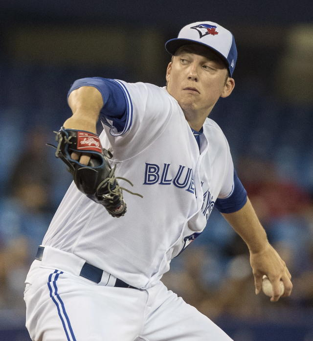 Toronto Blue Jays starting pitcher Ryan Borucki throws to a Boston Red Sox batter during the first inning of a baseball game Thursday, Aug. 9, 2018, in Toronto. (Fred Thornhill/The Canadian Press via AP)