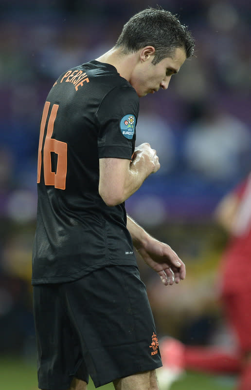 Dutch forward Robin van Persie reacts during the Euro 2012 football championships match Portugal vs. Netherlands, on June 17, 2012 at the Metalist stadium in Kharkiv. Portugal won 2 to 1.          AFP PHOTO / FILIPPO MONTEFORTEFILIPPO MONTEFORTE/AFP/GettyImages