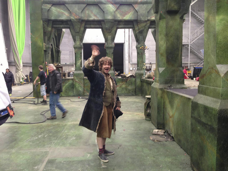 """In this Friday, July 12, 2013 photo taken and released by Peter Jackson, actor Martin Freeman waves after he finished his last filming shot as Bilbo Baggins on the set of The Hobbit in Wellington, New Zealand. Jackson has wrapped up filming """"The Hobbit"""" trilogy and shared pictures of his last day on the set with his Facebook fans. The New Zealand filmmaker provided a steady stream of updates and photos from the set of the final film, """"The Hobbit: There And Back Again,"""" on Friday, July 26. The second film, """"The Hobbit: The Desolation of Smaug,"""" will be released in December, and the finale appears in 2014. (AP Photo/Peter Jackson) MANDATORY CREDIT"""