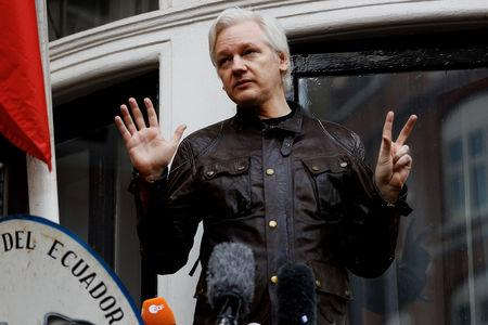 FILE PHOTO: WikiLeaks founder Julian Assange is seen on the balcony of the Ecuadorian Embassy in London, Britain