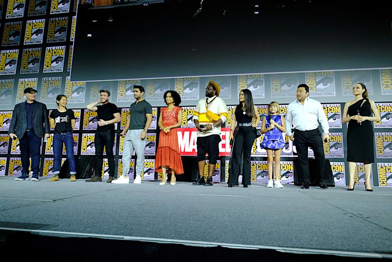 SAN DIEGO, CALIFORNIA - JULY 20: (L-R) President of Marvel Studios Kevin Feige, director Chloe Zhao, Richard Madden, Kumail Nanjiani, Lauren Ridloff, Brian Tyree Henry, Salma Hayek, Lia McHugh, Don Lee and Angelina Jolie of Marvel Studios' 'The Eternals' at the San Diego Comic-Con International 2019 Marvel Studios Panel in Hall H on July 20, 2019 in San Diego, California. (Photo by Alberto E. Rodriguez/Getty Images for Disney)