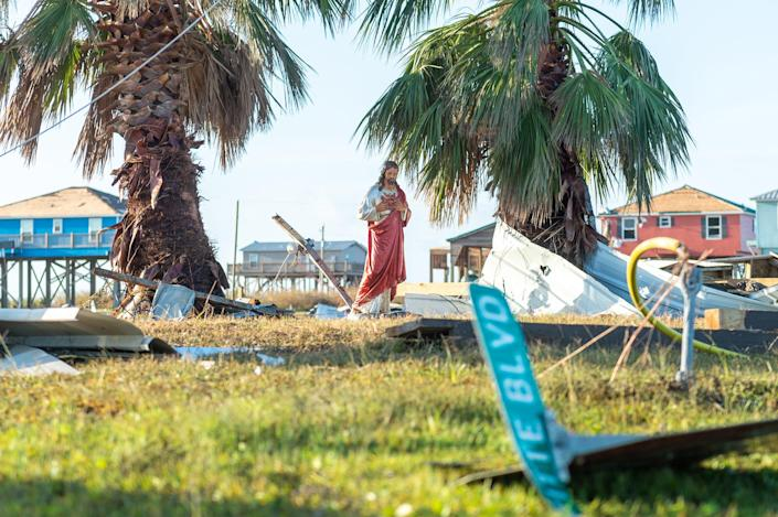 A statue of Jesus remains on a lot where a camp in Holly Beach was destroyed by Hurricane Laura.