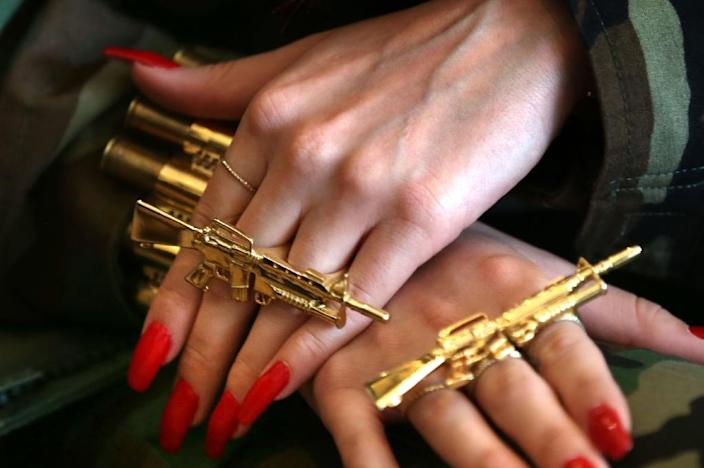 Helly Luv wears rings in the shape of automatic riffles during an interview with AFP in Arbil (AFP Photo/Safin Hamed)