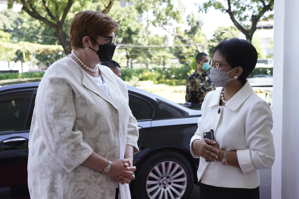 In this photo released by the Indonesian Ministry of Foreign Affairs, Australian Foreign Minister Marise Payne, left, talks with her Indonesian counterpart Retno Marsudi during their meeting in Jakarta, Indonesia, Thursday, Sept. 9, 2021. Australia's foreign and defense ministers are visiting Indonesia, India, South Korea and the United States to bolster economic and security relationships within the Asia-Pacific region, where tensions are rising with China. (Indonesian Ministry of Foreign Affairs via AP)