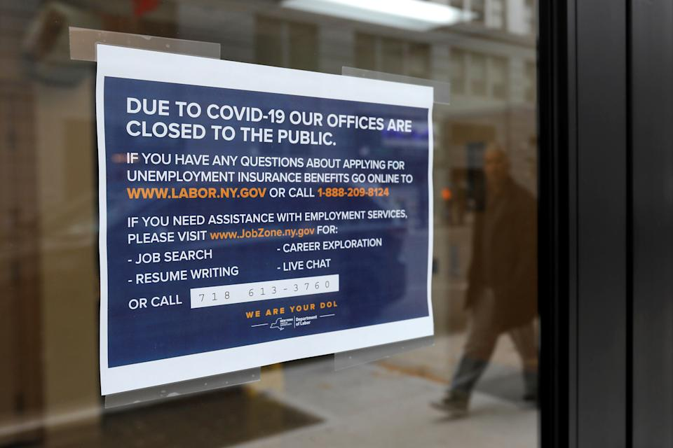 Signage is seen posted on the entrance of the New York State Department of Labor offices, which closed to the public due to the coronavirus disease (COVID-19) outbreak in the Brooklyn borough of New York City, U.S., March 20, 2020. REUTERS/Andrew Kelly