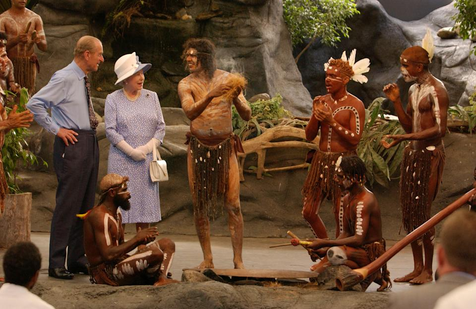 Britain's Queen Elizabeth II and the Duke of Edinburgh watching a culture show at Tjapukai Aboriginal Culture Park, Cairns, Queensland. The Duke surprised the aborigines when he asked them