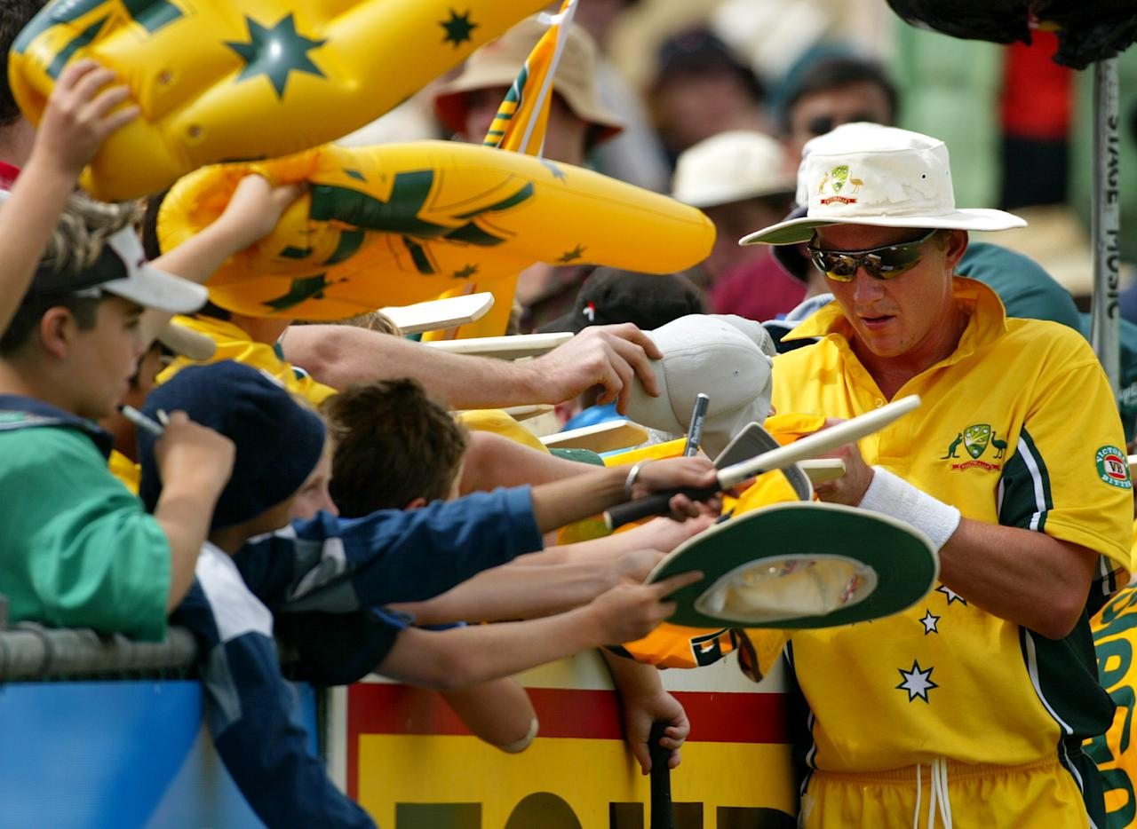 CAIRNS - AUGUST 2:  Brett Lee of Australia signs autographs for fans during the 1st One Day International between Australia and Bangladesh played at Bundaberg Rum Stadium on August 2, 2003, Cairns, Australia. (Photo by Hamish Blair/Getty Images)