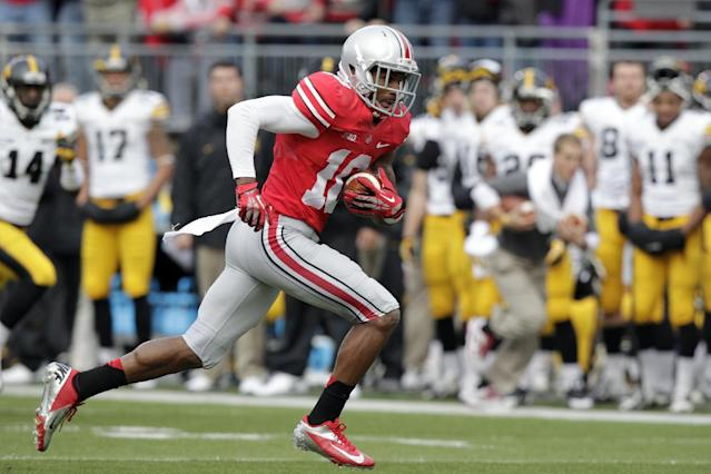FILE - In this Saturday, Oct. 19, 2013, file photo, Ohio State wide receiver Corey Brown runs against Iowa during an NCAA college football game in Columbus, Ohio. Brown was a good player for Ohio State a year ago. But he wasn't completely committed. His head coach said he wouldn't even walk across the street for him. But Brown has come full circle, as evidenced by his stirring, adults-only halftime speech last week which lifted the Buckeyes to yet another victory.(AP Photo/Jay LaPrete, File)