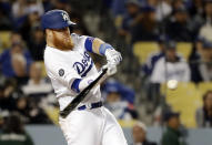 Los Angeles Dodgers' Justin Turner hits a two-run home run against the Atlanta Braves during the eighth inning of a baseball game Wednesday, May 8, 2019, in Los Angeles. (AP Photo/Marcio Jose Sanchez)