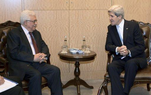 US Secretary of State John Kerry (R) speaks with Palestinian President Mahmoud Abbas on April 21, 2013, in Istanbul