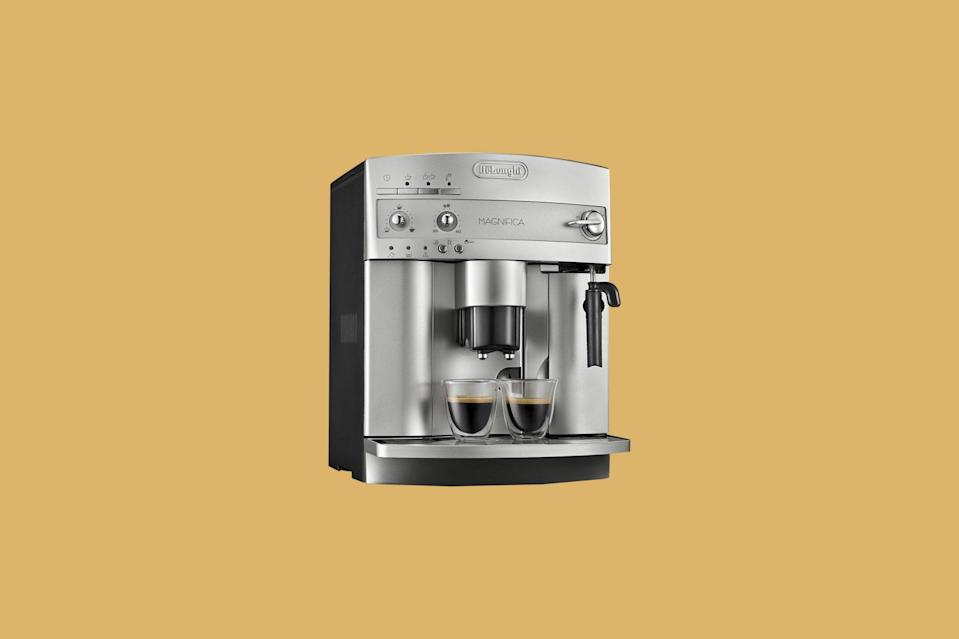 """<p>Espresso yourself with this sleek, programmable machine. With the touch of a button, it froths milk and uses a <a href=""""https://www.marthastewart.com/7975442/how-choose-coffee-grinder"""" rel=""""nofollow noopener"""" target=""""_blank"""" data-ylk=""""slk:conical burr grinder"""" class=""""link rapid-noclick-resp"""">conical burr grinder</a> to grind beans, then starts to brew your coffee on its own via its Direct-to-Brew system.</p> <p><strong><em>Buy Now</em></strong><em>: DeLonghi Magnifica Super-Automatic Espresso/Coffee Machine, $529.95, <a href=""""https://www.amazon.com/dp/B000N2YKQ0/ref=as_li_ss_tl?ie=UTF8&linkCode=ll1&tag=mslhomecoffeemakersourpicksrgollinsep20-20&linkId=c041f237ceb1e7e4995f86cdf0c1df24&language=en_US"""" rel=""""nofollow noopener"""" target=""""_blank"""" data-ylk=""""slk:amazon.com"""" class=""""link rapid-noclick-resp"""">amazon.com</a>.</em></p>"""